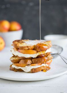 French toast + whipped lemony cream cheese with a dash of honey + fresh peaches or nectarines + a generous drizzle of honey = deliciously decadent breakfast treat that can be served as an open or c…