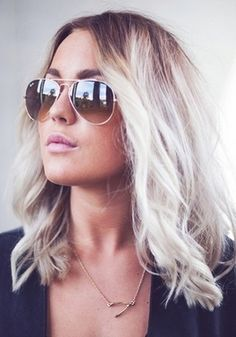 Pair loose waves with big sunglasses for a casual summer style