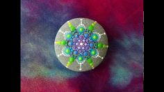 Stop motion mandala stone painting by Elspeth McLean