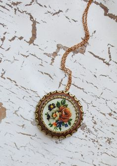 "Forgotten Flowers Indie Necklace 24.99 at shopruche.com. We are completely enchanted with this vintage inspired brass necklace, which features an embellished pendant and an antiqued floral design. Indie designed.  Chain: 17.5"", Pendant: 1.5"""