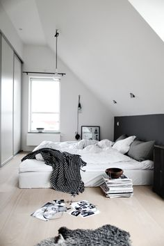 B L O O D A N D C H A M P A G N E . C O M: white room, grey black wall, bed on the floor
