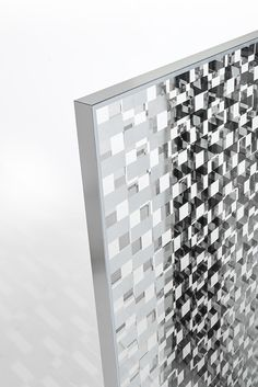 FRAGMENT screen | design Nendo | GLAS ITALIA 2017 collection |  Modular screen with a special checked decoration on double-sided mirror or in tempered bronze glass. Two perpendicularly checked crystals are applied to a double-sided silver shiny polished aluminum frame separated by a gap of a few centimeters and create a game of mirrored reflections, coverings and transparencies that deceive the observer, dissimulating and confusing the objects reflected from the ones screened and vice…