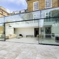 bi-parting maxlight doors, which slide over adjacent fixed panels to create large opening. Glass House Design, House Design, Glass House, House, Glass Door, Glass Extension, Glass Porch, Glass Boxes, House Extension Design