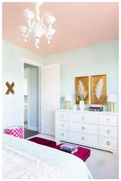 A pink ceiling beautifully complements light blue walls in this stylish girl's bedroom decorated with white and gold feather art pieces mounted above a white dresser accented with gold ring pulls and gold hammered lamps. Romantic Bedroom Decor, Bedroom Vintage, Trendy Bedroom, Bedroom Ideas, Kids Bedroom, Bedroom Images, Bedroom Modern, Design Bedroom, Gold Bedroom