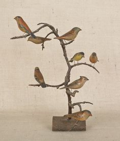 Sold For $ 2,400                                                          Pennsylvania carved and painted bird tree, ca. 1900, with eight decorated song birds, 16 3/4'' h.                            Condition report           Very good condition. No apparent damages or repairs.