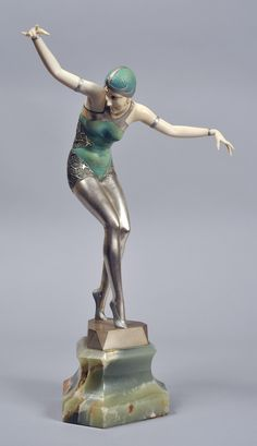 "Ferdinand Preiss bronze and ivory sculpture ""cabaret girl"" based on a photograph of Dorissa Nelova [Albertina Rasch Dancers]."
