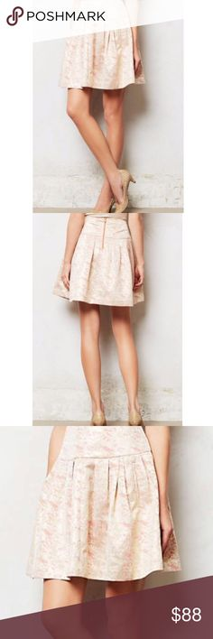 """Anthropologie Moulinette Soeurs Metallic Skirt Gorgeous skirt by Moulinette Soeurs from Anthropologie. Has fake pockets. Zips in back. Light metallic gold, light pink, and peach color. About 29"""" waist, 19.25"""" length. Lined. Self: 56% polyester, 44% rayon. #6291706 Anthropologie Skirts"""