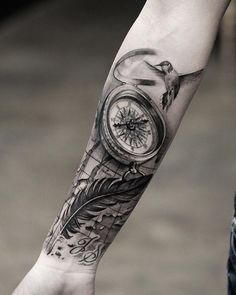 Compass and feather forearm tattoo - 100 Awesome Compass Tattoo Designs #armtattoosdesigns