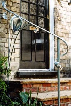 An organic handrail based around stylised plants - Panissue Share Exterior Handrail, Metal Deck Railing, Wrought Iron Handrail, Outdoor Stair Railing, Iron Handrails, Wrought Iron Stair Railing, Porch Railings, Iron Railings, Home Garden Design