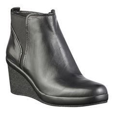 """Pull on bootie with gorging.  Side zipper closure.  Rubber sole.  Textured 2.5"""" wedge.  This style is available exclusively @ Nine West Stores & ninewest.com."""