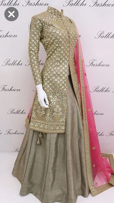 Be the sunshine of everybody's eye by dressing up in this very beautiful jacket lehenga from the all new range of palkhi fashion.this lehenga has been colored in dark beige.Crafted with pure gota work.Available with pink color embroidered net dupatta. Party Wear Indian Dresses, Designer Party Wear Dresses, Indian Gowns Dresses, Indian Fashion Dresses, Kurti Designs Party Wear, Dress Indian Style, Lehenga Designs, Indian Designer Outfits, Pakistani Dresses