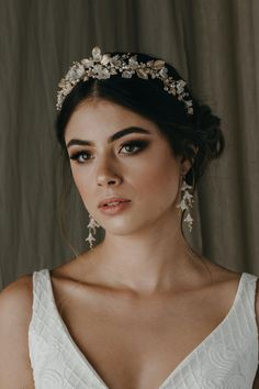 FLORES floral wedding headpiece 1 Flores is a floral wedding crown constructed from a dreamy palette of soft ivory, pale gold and silver tones. We love its decadent details and modern style. Bridal Crown, Bridal Tiara, Bridal Headpieces, Bridal Earrings, Drop Earrings, Headband Wedding Hair, Flower Headpiece Wedding, Bridal Hijab, Boho Wedding Hair
