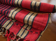 Naga handwoven blanket. Cotton handwoven textile From Nagaland in Myanmar a one of a kind Naga textile. These are very suitable for decorating around the house. New condition. Being handmade the weaving is not totally uniform. Measurements = length 62 ins width 38 ins  Traditional Naga tribe striped fabric. This is new, traditional style textile so condition is as new. Handwoven, Fairtrade product. * Fairtrade traditional product *  Orders are packed to go out within 3 days of payment (n...
