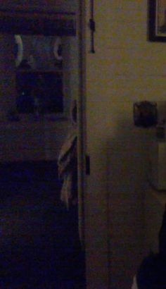 apparition of girl in hallway - taken by guest.at haunted sweet dreams inn of bay port, michigan. Call 586-322-6170 for reservations, and or a ghost hunt!