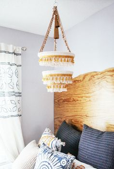 DIY Boho fringe chandelier | In Honor of Design.  Don't like the gold tassels, but the idea is great.