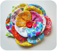 Scrappy bloom from tutorial here: http://keyka.typepad.com/my_weblog/2011/03/big-bloom-fabric-flower-tutorial.html