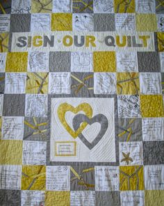 Close up of wedding guest book quilt for my son and daughter in law.  Guests signed 6 x 6 inch white squares at wedding; assembly of quilt was done later.                                                                                                                                                                                 More
