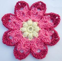 A free crochet pattern Octagon Flower. A large crochet flower with puff stitch center. Eight petalled crochet flower. Grannies Crochet, Crochet Motifs, Crochet Flower Patterns, Crochet Squares, Knit Or Crochet, Crochet Crafts, Yarn Crafts, Crochet Hooks, Crochet Projects