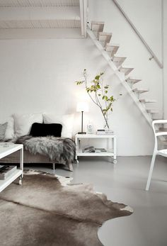 Country Life / Big City Life pour chez FLoG. Monochrome living space. White, grey, gray, black, hide rug.