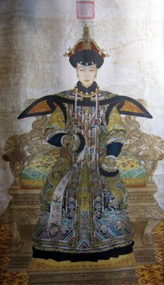 Empress Dowager Cixi, or Empress Dowager Tzu-hsi was a powerful and charismatic woman. Looking at the old photos of Cixi, we could get a general impression of the styles of cheongsam in Qing Dynasty.