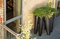 The Vases Outdoor Planter by Serralunga. A true sculpture inspired by the seabed, comprised of 5 cones with differing textures. The pot is made from linear low-density polyethylene achieved by rotational moulding.