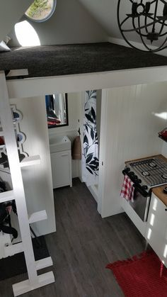 A custom 280 square feet tiny house on wheels built by Robert & Bettina Johnson in Alkali Lake, British Columbia, Canada.