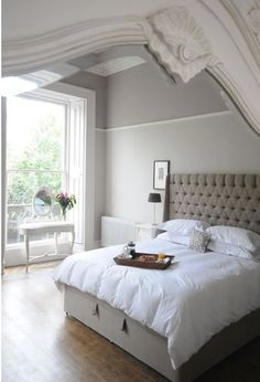Love this tufted headboard in this neutral setting.  The ultimate in feminine style!