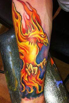 Phoenix bird tattoo on forearm