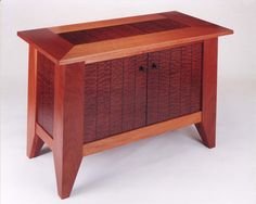 this cabinet was designed to house stereo equipment and cd storage it is constructed of solid mahogany pommele sapele veneer and ebony inlay