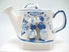Ceramic delft blue that will add a Dutch theme to your home! - Features Kissing Couple - Hand painted - See our collection for more unique Delft Blue Porcelain items! - See our collection for more uni