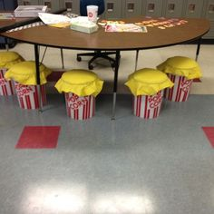 Movie Themed Classroom / Popcorn inspired bucket seats-so many things I could do with this theme! Popcorn Theme Classroom, Circus Theme Classroom, Stars Classroom, 3rd Grade Classroom, Classroom Door, Classroom Design, School Classroom, Movie Classroom, Classroom Layout