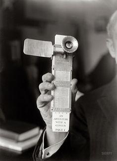Circa 1922, the Fiske Reading Machine in the hand of its inventor, Rear Admiral Bradley Fiske - Harris + Ewing