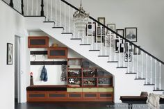 In a lot of homes, at the end of the staircase there's a wall that meets the stair treads and behind it is extra storage space in the form of a closet or shelving. Against a stairwell, the no fail accent is a console table or bench but let's say there's an empty space under the stairs …