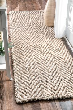 Get the earthy rustic look with amazingly striped patterned, handwoven and 100 percent natural fiber jute rug. The rug is thick and perfect for any indoor interior setting.