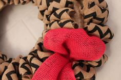 Adding burlap in layers to the wreath
