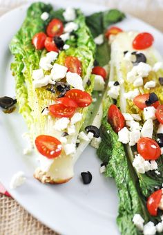 OMG super easty and delish! Used our indoor grill topped with feta, tomaotes and olive oil. Would be great with just about any veggie on top.//June 2013//Grilled Romaine Lettuce with Feta, Tomato & Olives