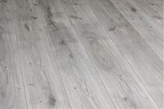 Grey oak floor, pale fumed and wire brushed.