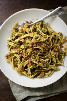 A quick, vegan pesto pasta that features a pesto made with parsley, basil, sun-dried tomatoes, and kalamata olives. Ready in 15 minutes.