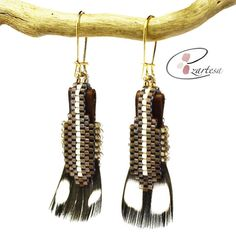 Native American Inspired feather earrings, with natural feathers, brown leather, and glass seed beads.