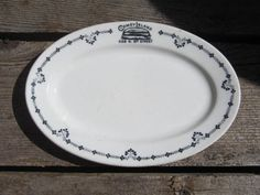 "This is a small restaurant ware platter with a ""Coney Island"" logo and the address of 528 N 8th Street...no city given but I think it might be Sheboygan, Michigan. The mark on the back is ""American China & Glass Co, Chicago, Ill -Maddock's- Trenton China"" and embossed in the clay is ""Scammell's Trenton China"". The platter is 8 1/2"" wide and shows signs of light use with knife marks, surface wear and a few places with slight discoloration. Ne..."