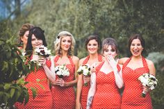 Bridesmaids in red polka dot halter style dresses! A Glastonbury Themed Wedding at the Eden Project, Cornwall.  Photography: http://www.alanlawphotography.co.uk/