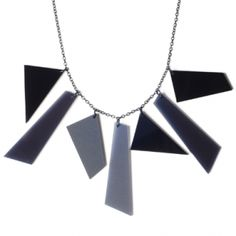 $115 Graphic necklace. Laser cut acrylic glass in shades of black