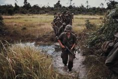 """""""Vietnam....Members of Company B, 1st Battalion, 27th Infantry (Wolfhounds), 25th Infantry Division, cross a stream approximately 15 kilometers southeast of Nui Ba Den during search and clear operations near fire Support Base Kien, 21 Aug 70."""" (Photo by SP4 Peter Finnegan, DASPO."""
