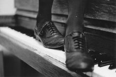 Oxfords on a piano
