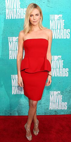 CHARLIZE THERON in LANVIN  design peplum and Jimmy Choo sandals.MTV Movie Award.