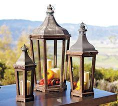 I love pottery barn lanterns, and use them outside and inside. You can sometimes find similar ones at Home Goods.