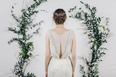 Isadora wedding hair vine pinned into back of the head low bun up do