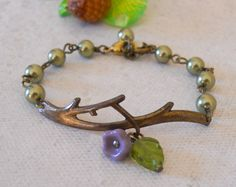 Hey, I found this really awesome Etsy listing at http://www.etsy.com/listing/83114903/twig-bracelet-charm-bracelet-olivine