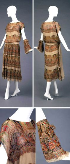 Paisley chiffon dress, Martial & Armand, 1923. Light gold, green, blue, & black. Has boat neck, short kimono sleeves, 3 pleated tiers from dropped waist in front only. Light gold sash with paisley pleated sash ornament. Light gold silk slip from waist. Goldstein Museum of Design, Univ. of Minnesota