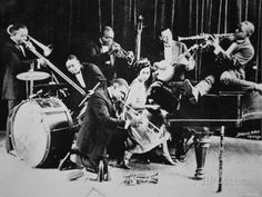 Jazz was African American music of the 1920s, and spread out in Canada rapidly. Jazz music combined elements of ragtime, blues, spirituals, and band music. Charleston, Black Bottom and Fox Trot were the most popular dances. 1920s also known as The Jazz Age. It encouraged daring and energetic dances. Jazz involved to the people's life but also challenged some people's mind because of their suggestive movements. Some call these years the 'age of wonderful nonsense'. (Photography 1920)